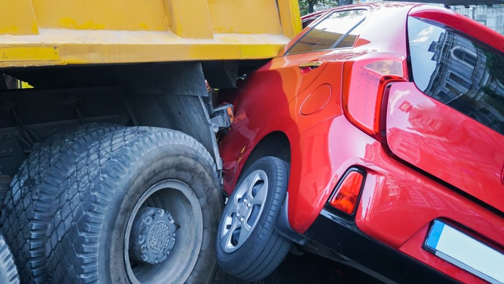 Delivery Truck Hits Car